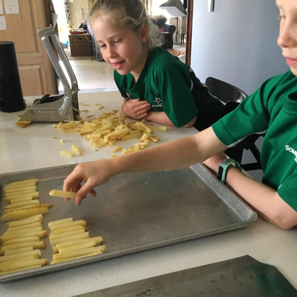 kids helping make baked fries
